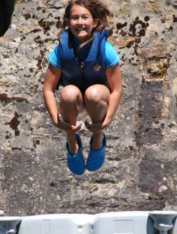 Girl coasteering in a quarry at Via Ferrata Cornwall