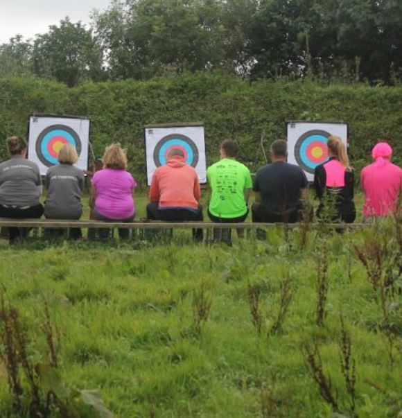 A group playing archery at a corporate away day at Via Ferrata Cornwall