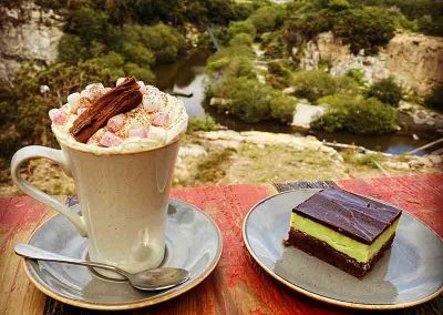 Cafe with wild play areas nearby overlooking the quarry with cake and hot chocolate with marshmallows