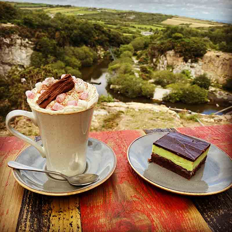 Cafe with play area nearby overlooking the quarry with cake and hot chocolate with marshmallows