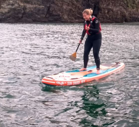 Stand-up paddleboarding in the quarry at Via Ferrata Cornwall near Falmouth
