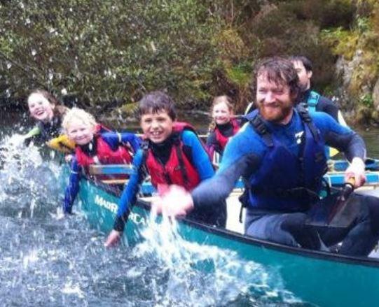 Family splashing in a canoe