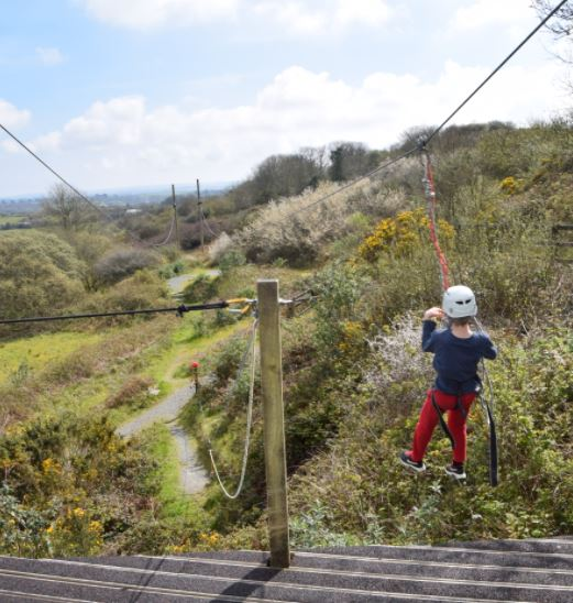 Boy goes zip-lining at our adventure holiday club