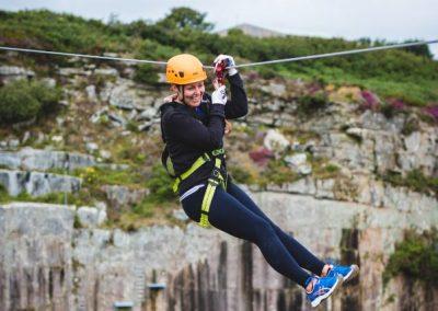 Lady ziplining at a birthday party at Via Ferrata Cornwall
